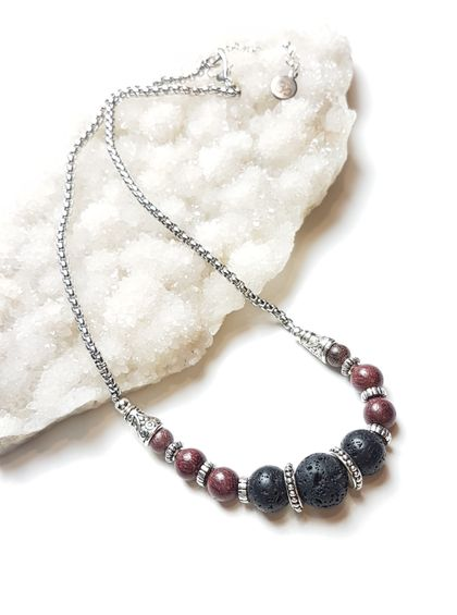 Grounded in compassion - rosewood and basalt diffuser necklace.