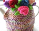 beautiful hand knitted coloured roses tea cosy