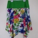 Floral skirt with crooked hem and green waistband