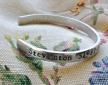 Jane Austen's birthplace.Steventon, Hampshire.Unique hand stamped aluminium cuff bangle,adjustable.Latitude and longitude for Pride and Prejudice lovers!1/4 by 6 inches.Christmas,birthday,book lover's,book club gift.