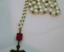 Vintage faux pearls with spectacular vintage glass rhinestone and brass cross