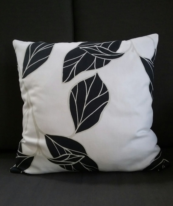 Black patio furniture cushions can feel a bit overwhelming in small spaces. If you've already got a lot of black on your patio, adding solid cushions may be too much as well. Look to mix in patterns like black and white polka dots to break up the color and add a little fun to your outdoor space.
