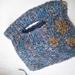 Hand knitted, wool blend handbag.