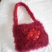 Hand knitted fluffy yarn bag