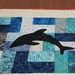 Quilted table runner in batiks with dolphins