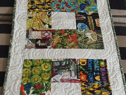Quilted table runner in Kiwiana prints