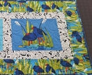 Quilted table runner - kiwiana prints with Pukekos
