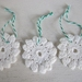 Three crochet Christmas decorations - perfect for the tree, the home, or as gift tags.