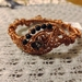 Elaborate wire wrapped copper bangle with sandstone beads