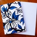 GREETING CARD - AN ILLUSTRATED FLOWER PATTERN IN BLUE