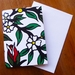 GREETING CARD - AN ILLUSTRATED FLOWER PATTERN IN GREENS AND RED