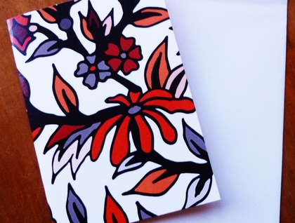 GREETING CARD - AN ILLUSTRATED FLOWER PATTERN IN RED