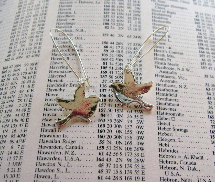 Taking off earrings in bright silver