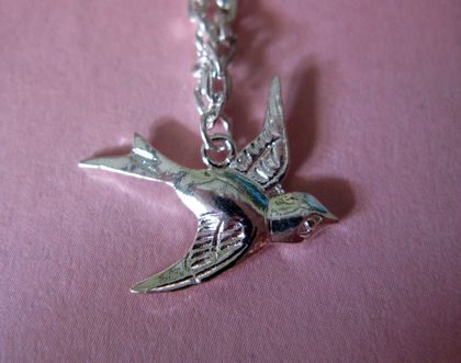 tiny swooping bird necklace