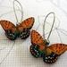 Tan spotted butterfly earrings