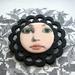 doll-face brooch