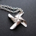Silver pinwheel necklace