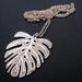 Palm leaf on long chain