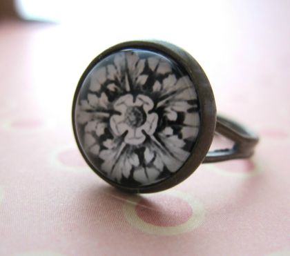 black and white flower and leaf design ring