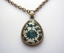 blue patterned teardrop glass dome necklace