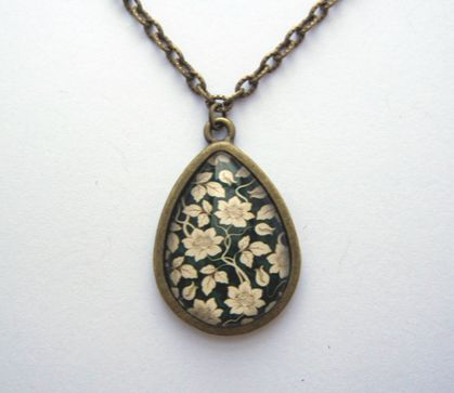 flowering vine patterned teardrop glass dome necklace