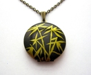 Bamboo patterned locket necklace