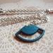 metallic teal woodcut necklace