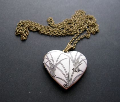 pretty black and white heart locket necklace
