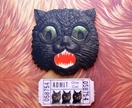 Giant cat with a ticket - woodcut magnet duo