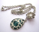 Blue floral patterned teardrop necklace with silver flower