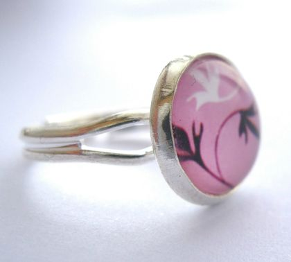 black and white leaf design on pink ring