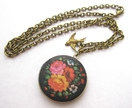 Floral burst locket necklace