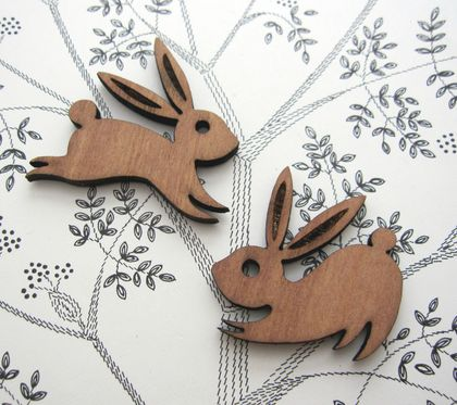 Playful rabbits - woodcut magnet duo