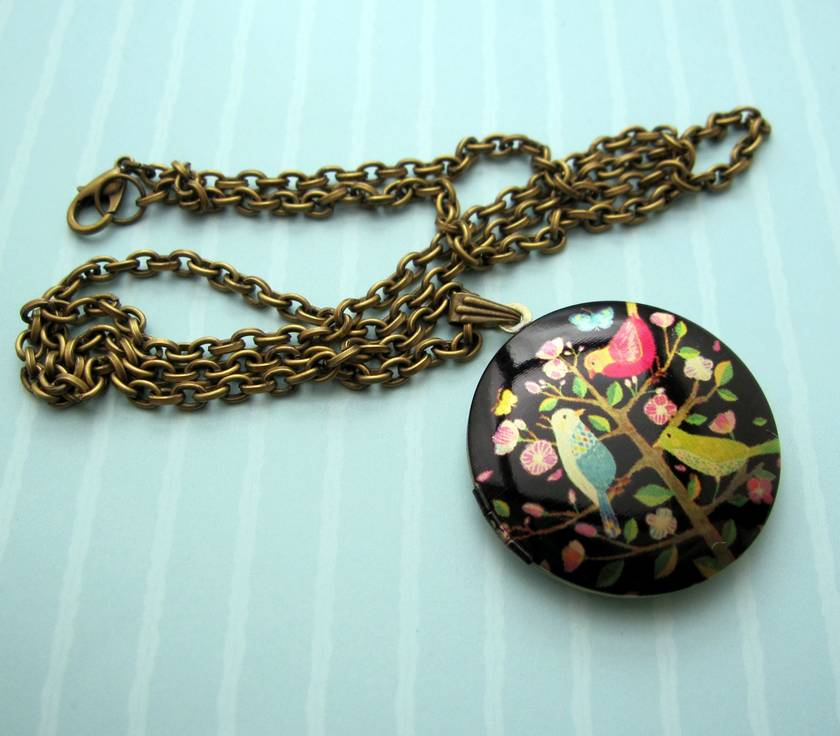 Patterned brass locket necklace - bright birds on a flowering tree.