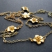 Long gold chain with cherry blossoms