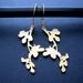 gold flowering branch earrings