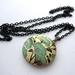 Full bloom locket necklace