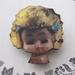 Doll head brooch