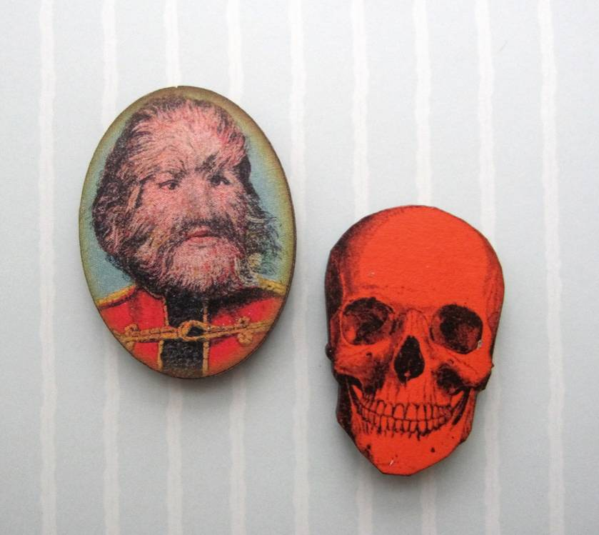 woodcut magnet duo.  Side show freak and skull.