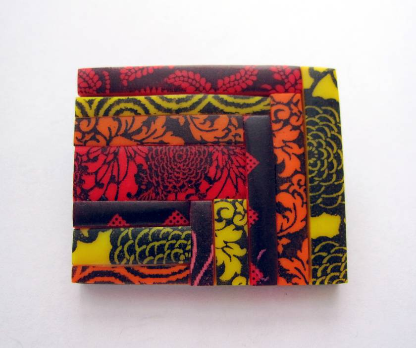 patchwork brooch in fiery red, yellow and orange