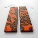 Orange and black long asian design earrings