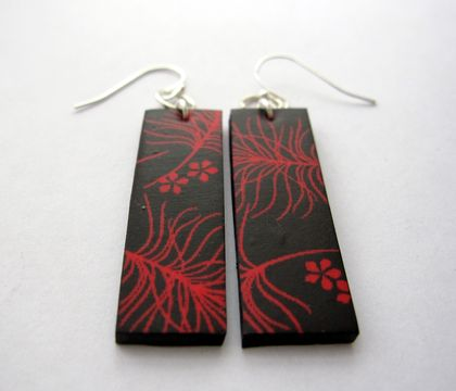 Red feather and flower earrings