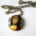 Mona Lisa locket necklace