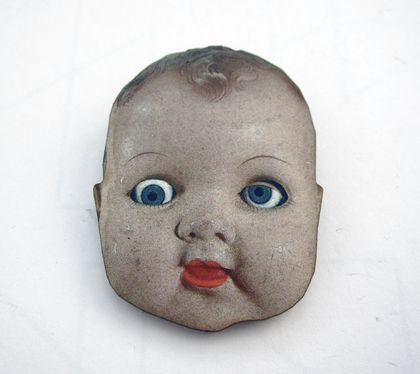 Doll head brooch