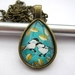 birds on a branch - teardrop glass dome necklace