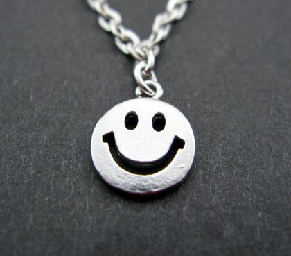 Tiny happy face necklace