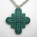 Stylized art nouveau cross necklace in teal on a chunky chain