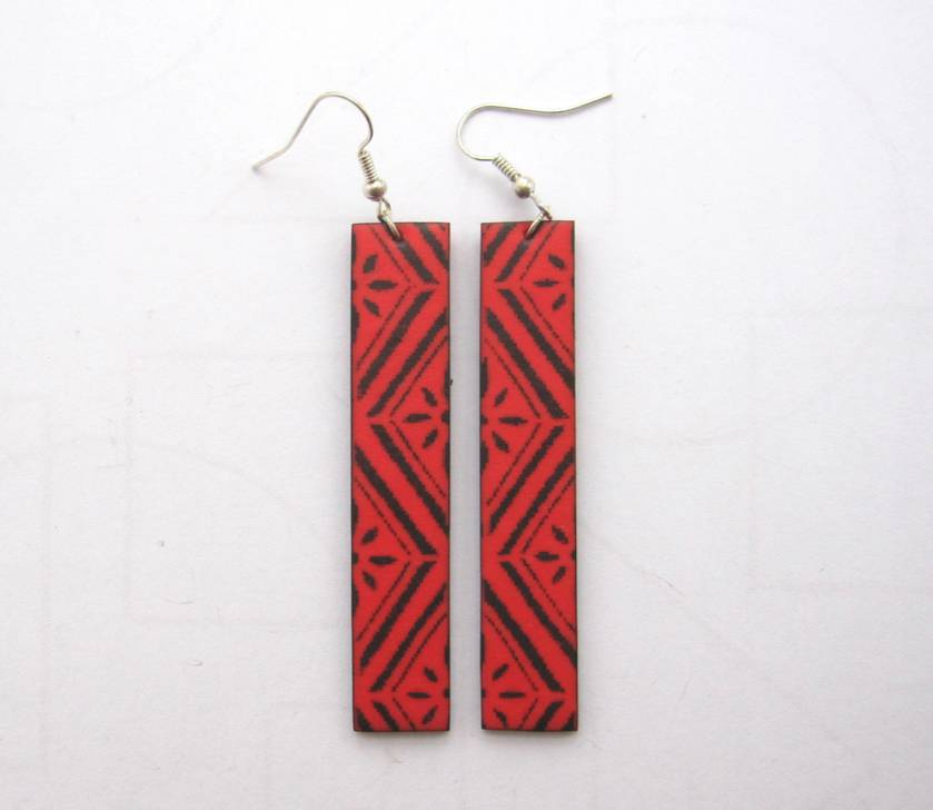Long bright red patterned earrings
