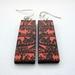 peach and black folk forest earrings