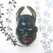 Tribal mask brooch